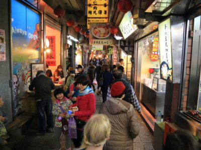 The main street 'Jioufen Kiyama city day and night filled with vibrant, featuring souvenir Jioufen