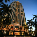 The Peninsula Bangkok along the Chao Phraya River in glittering evening atmosphere